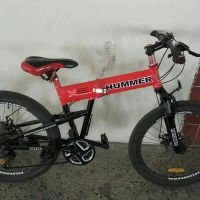 For sale a red hummer bicycle
