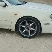 maxima rims with tire