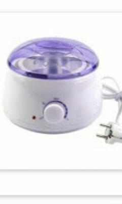 Wax heating device for hair removal