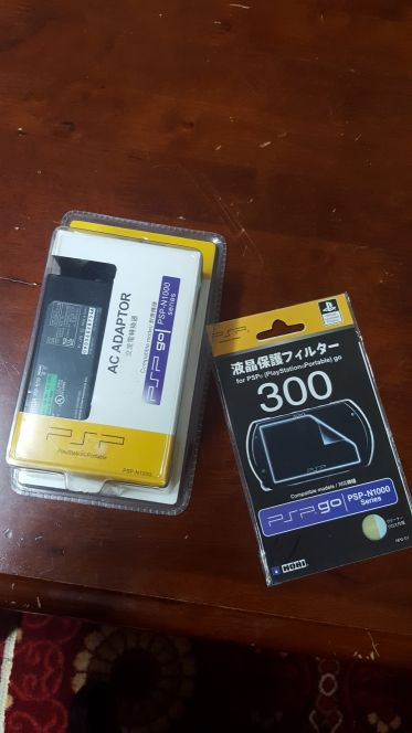 psp go charger + screen protector
