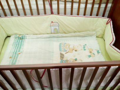 bed for baby with sheet from baby shop