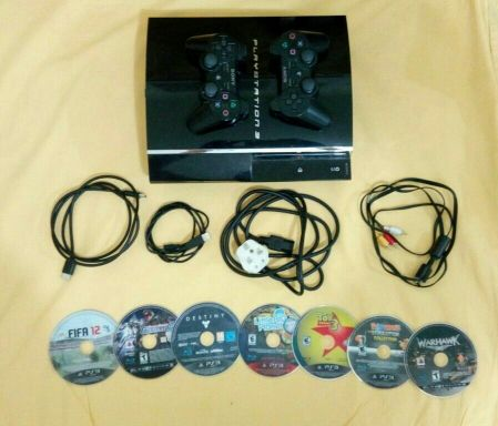 PS3 with 5 game's and 7 CDs