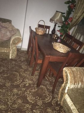 A dining table with six chairs Malaysian