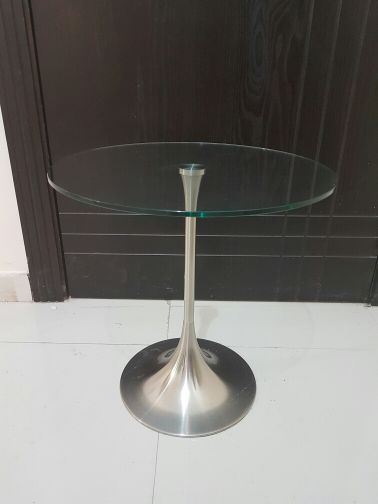 two rounded glass tables flawless