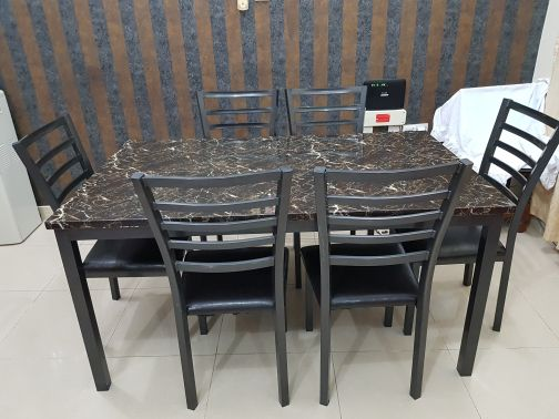 Dining table with 6 chairs from Pan