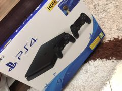 PS4 1TB with 2 controllers