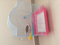 Bird cage with a nest