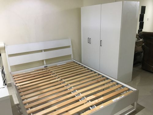 Bed and cabinet