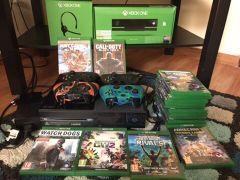 Xbox1 with 18 games and camera...