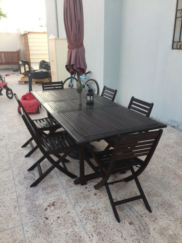 Wooden table, chairs,umbrella