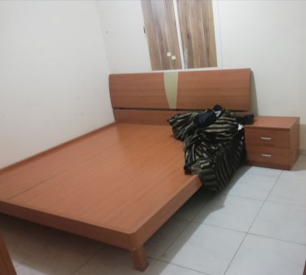 King size bed with small side table