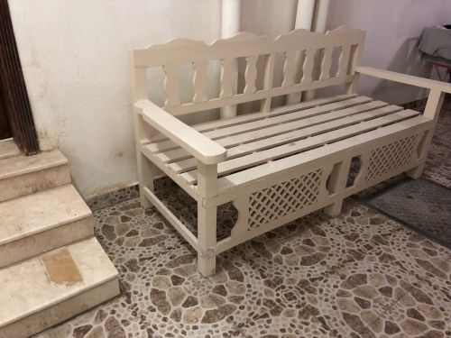 Two wooden chairs with pads.