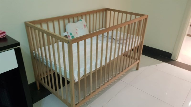 good condition cot with a new mattress