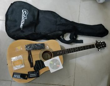 Box Guitar with extra strings and tuner