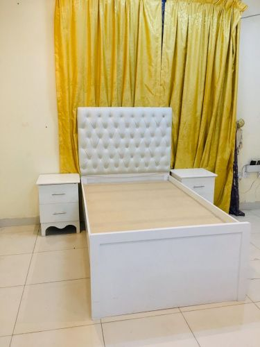 single bed and 2 side table