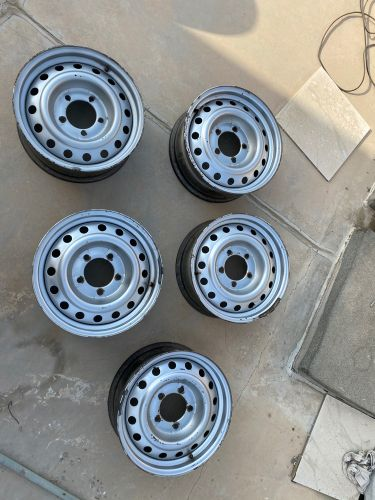 """5 Used copy 17"""" rims with bolts"""