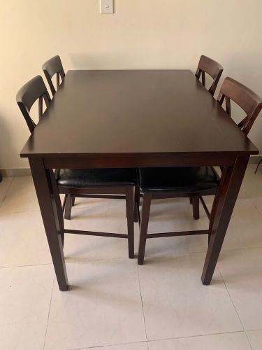 Table and four leather chairs