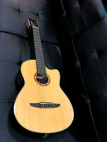 Yamaha ncx900r guitar with case, capo, new strings and all i
